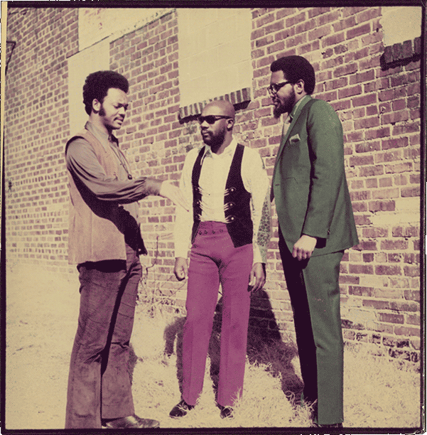 Jesse Jackson, Isaac Hayes and Al Bell talking outside Stax recording studio