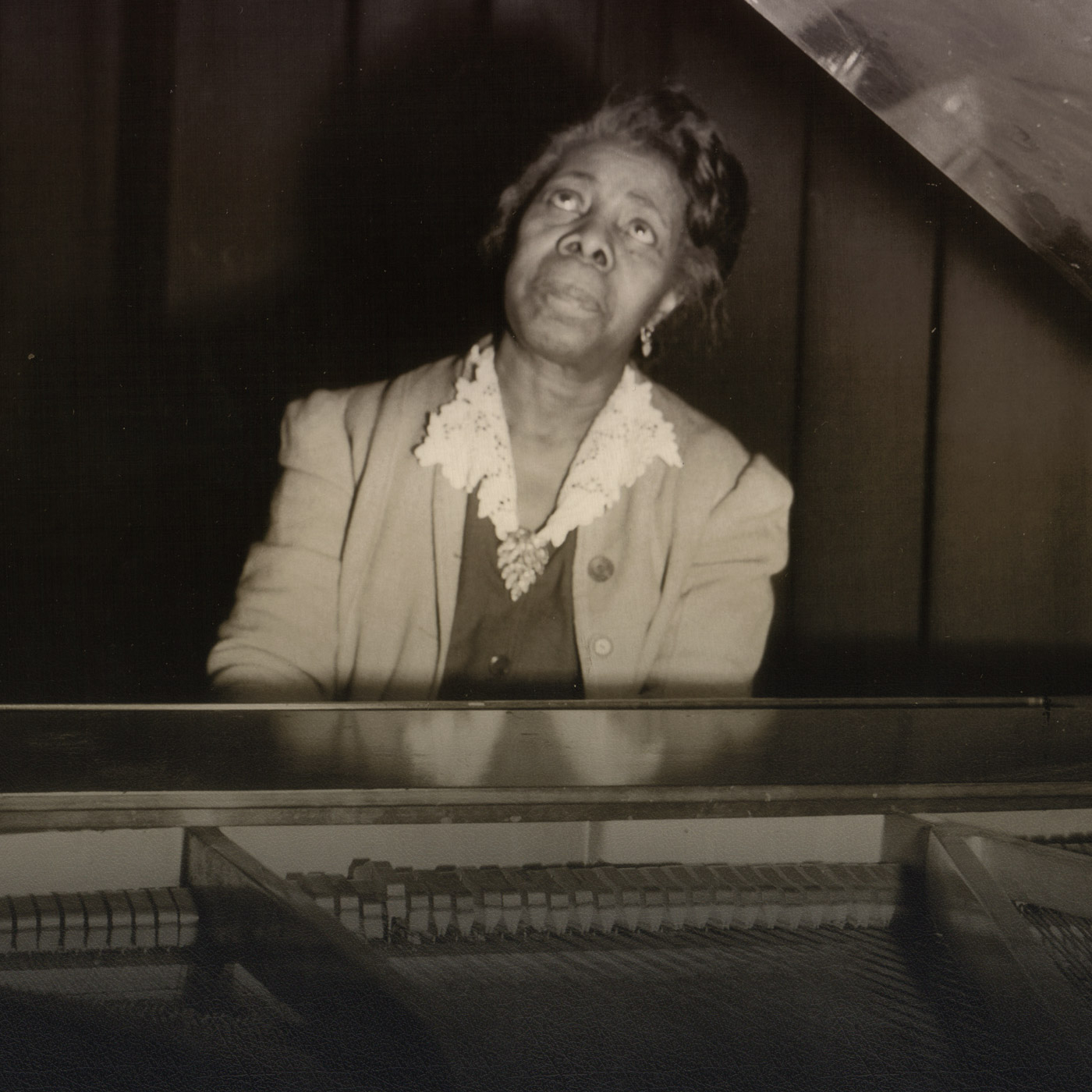 Lucie Campbell behind a grand piano
