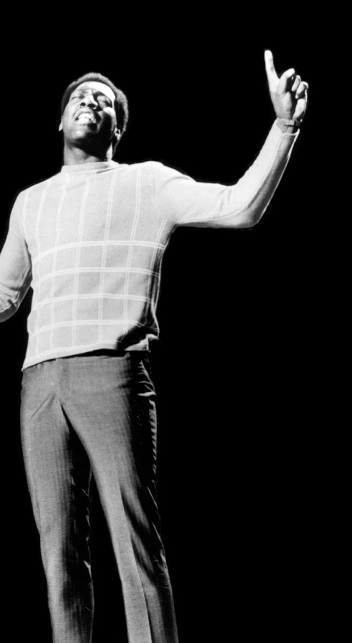 Otis Redding performing on stage