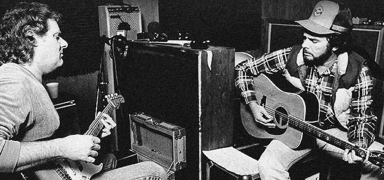 Reggie Young and Merle Haggard play guitar