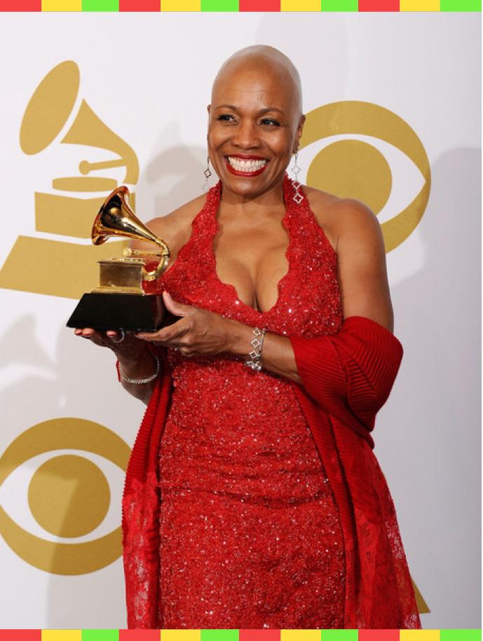 Dee Dee holds her Grammy award trophy
